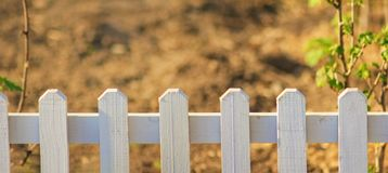 Beautiful  garden with white fence royalty free stock photography