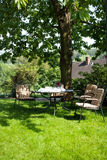 Beautiful garden with white table and chair Royalty Free Stock Photos