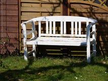 Beautiful garden wooden bench seating corner Stock Photography