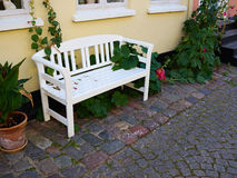 Beautiful garden wooden bench seating corner Stock Photos