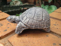 Beautiful Gardens 002 by Kambas. Grey stone turtle ornament with patterns on its shell Stock Photo