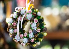 Beautiful Garland with Roses, Pine Cones, Leaves and Green Elements stock image