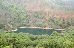 Beautiful Garud tal in the mid of dense Forest. Garud tal/lake is a beautiful small lake surrounded by dense forest near Sattal Royalty Free Stock Photo