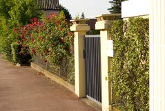 Beautiful gate, entrance to a front yard Stock Photos