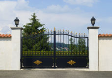 Beautiful gate, entrance to a front yard Royalty Free Stock Photos