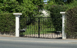 Beautiful gate, entrance to a front yard Royalty Free Stock Image