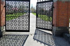Beautiful gate to the cemetery. The gateway to the cemetery, a smooth gate that gives beautiful shadow patterns Royalty Free Stock Photos