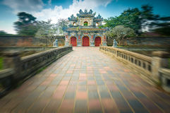 Beautiful gate to Citadel of Hue in Vietnam, Asia. Facade of Citadel gate in Hue, Vietnam, Asia. Ornate entrance to Hue Imperial City. Bright day with blue sky stock photos