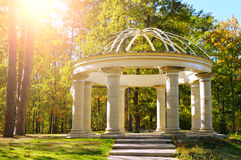 Beautiful gazebo in autumn park. And sun Royalty Free Stock Photography