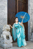 Beautiful geisha with a blue umbrella Stock Images