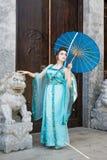 Beautiful geisha with a blue umbrella Royalty Free Stock Photography