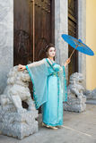 Beautiful geisha with a blue umbrella Stock Photography