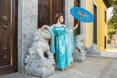 Beautiful geisha with a blue umbrella Royalty Free Stock Image
