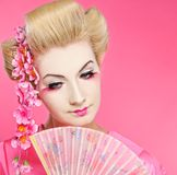Beautiful geisha with fan Royalty Free Stock Photo