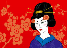 Beautiful geisha in a kimono. On a red floral background Stock Photography
