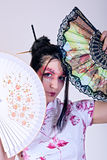 Beautiful geisha. Portrait of beautiful geisha with fans stock images