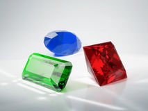 Beautiful gems. Emerald, ruby and sapphire. 3D illustration Royalty Free Stock Photo