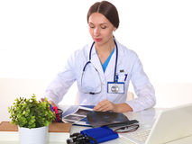 Beautiful general practitioner is working with joy. She is standing with a folder of documents in her hand Royalty Free Stock Images