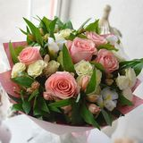 Beautiful gentle bouquet of roses on a table royalty free stock images