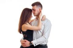 Beautiful gentle girl hugs her boyfriend Stock Images