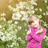 Beautiful gentle girl standing in a  lush garden. Beautiful gentle girl standing in a lush garden Royalty Free Stock Photos