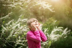 Beautiful gentle girl standing in a lush garden Royalty Free Stock Images