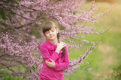 Beautiful gentle girl standing in a lush  garden Stock Photography
