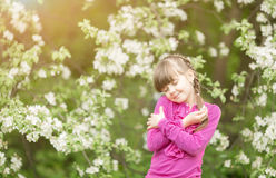 Beautiful gentle girl standing in a lush garden. Beautiful gentle girl standing  in a lush park Stock Photos