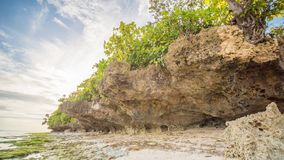 Beautiful gentle nature of the Philippines. The island of Bohol. A beach with sloping cliffs. Anda. Poblacion village. stock photos