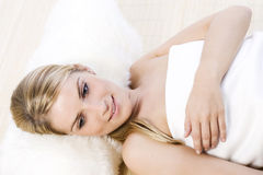 Beautiful gentle woman relaxing at a spa Royalty Free Stock Image
