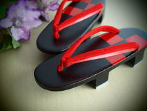 Beautiful geta. Red and black geta the japanese footwear for kimono Stock Image