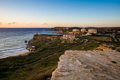 Ghajn Tuffieha Bay on Malta. Beautiful Ghajn Tuffieha Bay taken during colorful sunset on Malta island. Beautiful landscape in south Europe Royalty Free Stock Photo