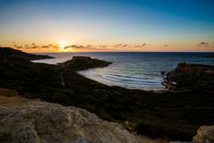 Ghajn Tuffieha Bay on Malta. Beautiful Ghajn Tuffieha Bay taken during colorful sunset on Malta island. Beautiful landscape in south Europe Royalty Free Stock Photos