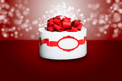 Beautiful gift. Beautiful colorful red gift with a red background and bokeh royalty free stock images