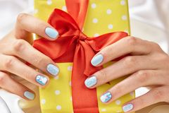Beautiful gift box in female hands. Stock Images