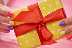Beautiful gift box in female hands. Royalty Free Stock Photography