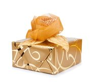 Beautiful gift box in gold paper with a silk rose Royalty Free Stock Photography