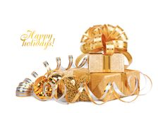 Beautiful  Gift box in gold wrapping paper Royalty Free Stock Images