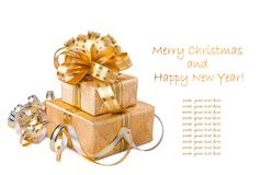 Beautiful  Gift box in gold wrapping paper Stock Photography