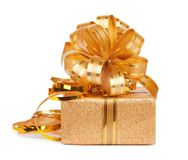 Beautiful  Gift box in gold wrapping paper Stock Photos