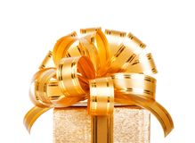 Beautiful  Gift box in gold wrapping paper Royalty Free Stock Image