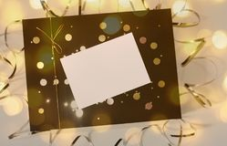 Beautiful gift box with golden ribbon and bow and empty card for text stock images