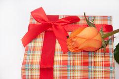 Beautiful gift box with red bow and orange rose Stock Photo