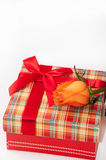 Beautiful gift box with red bow and orange rose Stock Photos