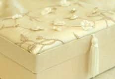 Beautiful gift box sheathed by silk with an embro Stock Image