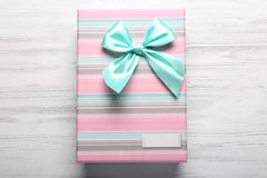Beautiful gift box on wooden background Royalty Free Stock Photos