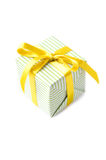 Beautiful gift box with yellow ribbon over white Royalty Free Stock Photo