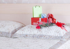 Beautiful gift boxes. And bouquets of roses on the bed Stock Images