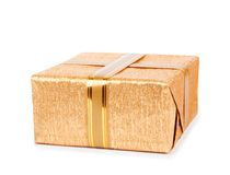 Beautiful  Gift boxes in gold wrapping paper Stock Photos