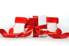 Beautiful gift boxes with red ribbons and branch of tree on a white background Royalty Free Stock Photography